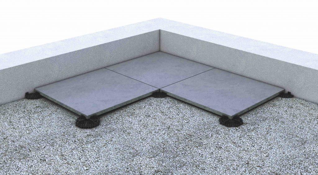 Renovatie terras met nieuwe tegel die op bestaande ondergrond wordt gelegd via lage tegeldrager.