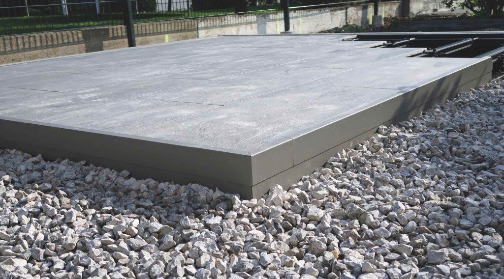 Beloopbaar dakterras creëren op bestaand plat dak met keien of groendak rondom.