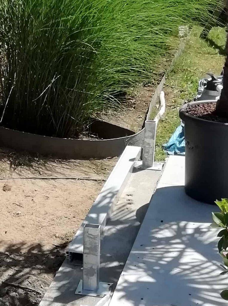 Schroefankers zetten tuinwand stevig vast